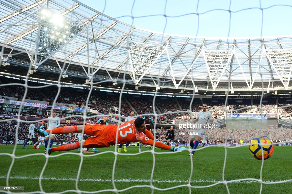 Marko Arnautovic of West Ham United (obscure) scores his sides first goal past Thibaut Courtois of Chelsea during the Premier League match between West Ham United and Chelsea at London Stadium on December 9, 2017 in London, England.