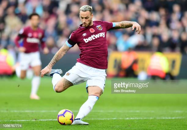 Marko Arnautovic of West Ham United scores his sides first goal during the Premier League match between West Ham United and Burnley FC at London...