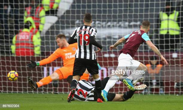 Marko Arnautovic of West Ham United scores his sides first goal during the Premier League match between West Ham United and Newcastle United at...