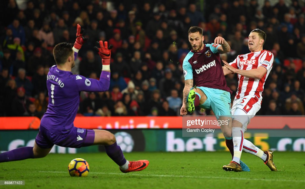Marko Arnautovic of West Ham United scores his sides second goal pat Jack Butland of Stoke City during the Premier League match between Stoke City and West Ham United at Bet365 Stadium on December 16, 2017 in Stoke on Trent, England.