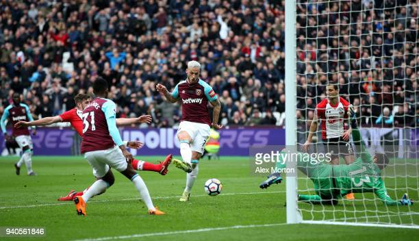 Marko Arnautovic of West Ham United scores his sides second goal during the Premier League match between West Ham United and Southampton at London...