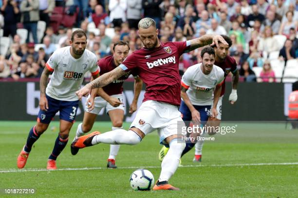 Marko Arnautovic of West Ham United scores his team's first goal during the Premier League match between West Ham United and AFC Bournemouth at...