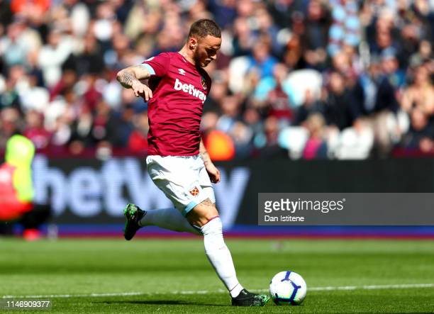 Marko Arnautovic of West Ham United scores his team's first goal during the Premier League match between West Ham United and Southampton FC at London...