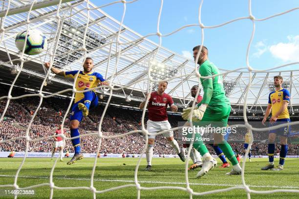 Marko Arnautovic of West Ham United scores his team's second goal past Fraser Forster of Southampton during the Premier League match between West Ham...