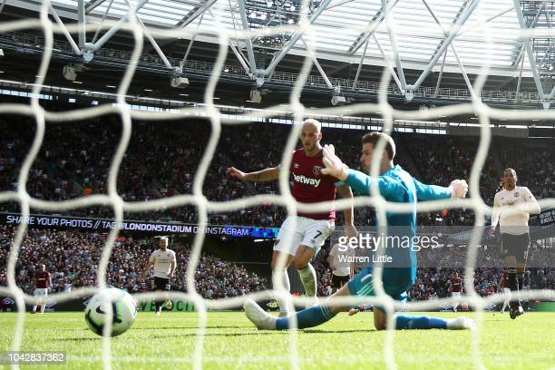 Marko Arnautovic of West Ham United scores past David De Gea of Manchester United for his sides third goal during the Premier League match between...
