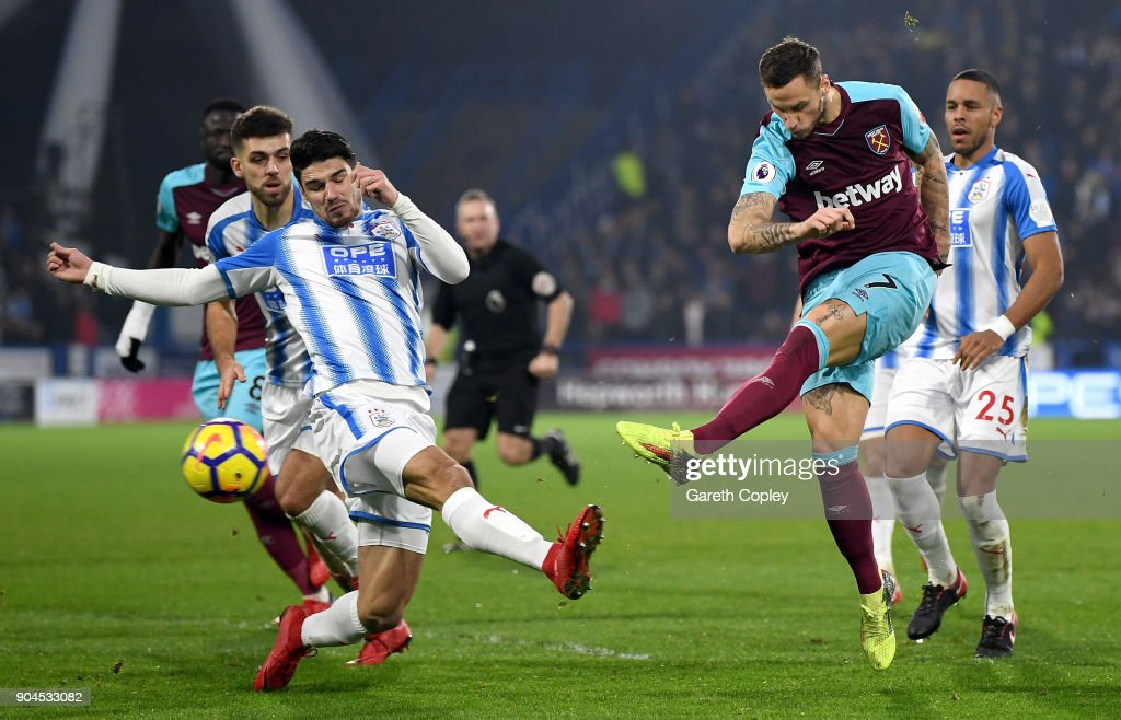 Marko Arnautovic of West Ham United scores their second goal during the Premier League match between Huddersfield Town and West Ham United at John Smith's Stadium on January 13, 2018 in Huddersfield, England.