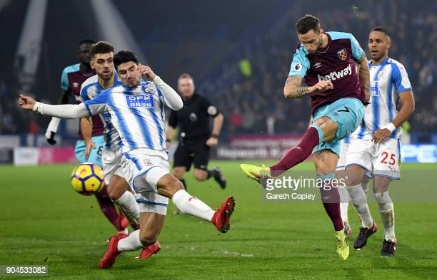 Marko Arnautovic of West Ham United scores their second goal during the Premier League match between Huddersfield Town and West Ham United at John...