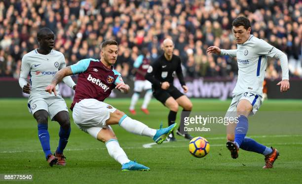 Marko Arnautovic of West Ham United shoots as Andreas Christensen of Chelsea attempts to block during the Premier League match between West Ham...