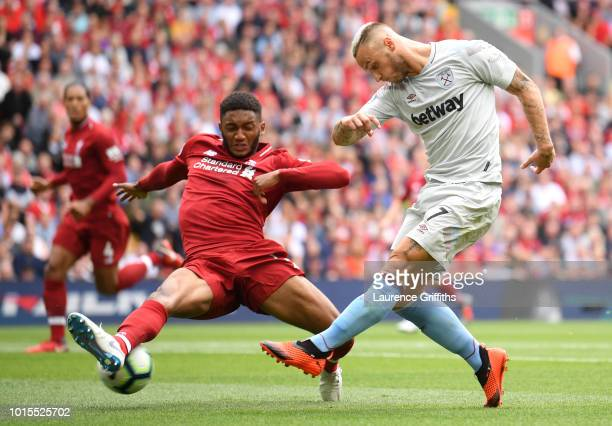 Marko Arnautovic of West Ham United takes a shot and is blocked by Joe Gomez of Liverpool during the Premier League match between Liverpool FC and...