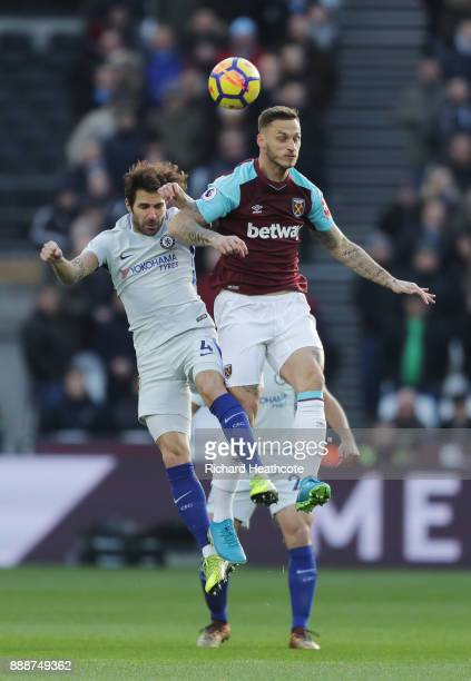 Marko Arnautovic of West Ham United wins a header over Cesc Fabregas of Chelsea during the Premier League match between West Ham United and Chelsea...
