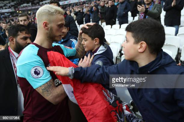 Marko Arnautovic of West Ham United with fans after the Premier League match between West Ham United and Burnley at London Stadium on March 10 2018...