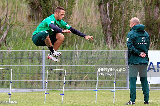 Marko Arnautovic practices next to head coach Thomas Schaaf during the SV Werder Bremen training session on July 4 2011 in Norderney Germany