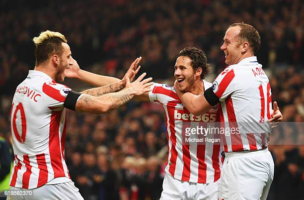 Marko Arnautovic Ramadan Sobhi and Charlie Adam of Stoke City celebrate as Alfie Mawson of Swansea City scores an own goal for their second goal...