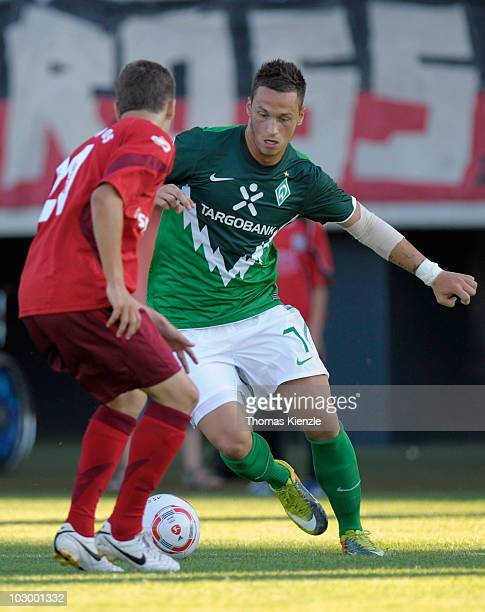 Marko Arnautovic vies for the ball with Philip Kuehnert of Reutlingen during a friendly match between SV Werder Bremen and SSV Reutlingen on July 20...