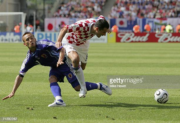 Marko Babic of Croatia is tackled by Hidetoshi Nakata of Japan during the FIFA World Cup Germany 2006 Group F match between Japan and Croatia at the...