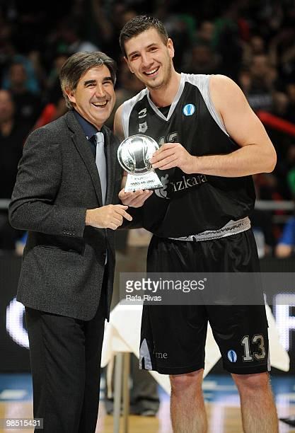 Marko Banic of Bizkaia Bilbao Basket is presented an award by President of Euroleague Jordi Bertomeu during the Best Season Players Award Ceremony at...