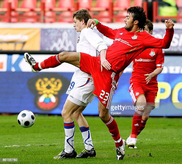 Marko Basa of FC Lokomotiv Moscow battles for the ball with Tomas Necid of PFC CSKA Moscow during the Russian Cup quarter final match between FC...