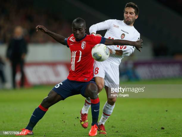 Marko Basa of Lille and Joao Filipe Moutinho of Monaco battle for the ball during the French Ligue 1 match between OSC Lille and AS Monaco at the...