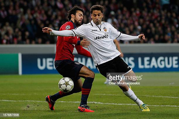 Marko Basa of Lille holds and fouls Jonas of Valencia to give away a penalty during the UEFA Champions League Group F match between OSC Lille and...
