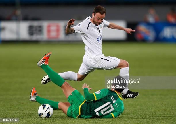 Marko Blazic of Bunyodkor challenges Wang Xiaolong of Beijing Guoan during the AFC Champions League Group match between Bunyodkor and Beijing Guoan...