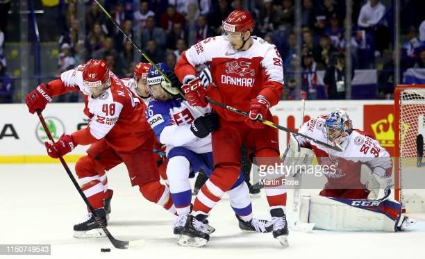 Marko Dano of Slovakia challenge Nicholas Jensen and Oliver Lauridsen of Denmark during the 2019 IIHF Ice Hockey World Championship Slovakia group A...