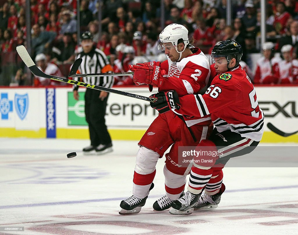 Marko Dano #56 of the Chicago Blackhawks battles for the puck with Brendan Smith #2 of the Detroit Red Wings during a preseason game at the United Center on September 22, 2015 in Chicago, Illinois.