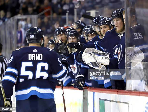 Marko Dano of the Winnipeg Jets celebrates his second period goal against the San Jose Sharks with teammates at the bench at the Bell MTS Place on...