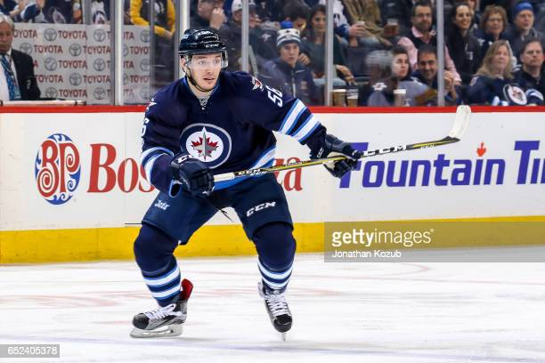 Marko Dano of the Winnipeg Jets follows the play down the ice during second period action against the Pittsburgh Penguins at the MTS Centre on March...