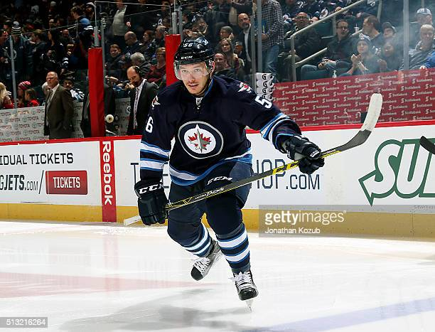 Marko Dano of the Winnipeg Jets hits the ice prior to puck drop against the Florida Panthers at the MTS Centre on March 1 2016 in Winnipeg Manitoba...