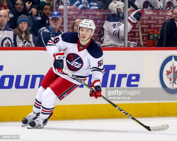 Marko Dano of the Winnipeg Jets keeps an eye on the play during first period action against the Minnesota Wild at the MTS Centre on March 19 2017 in...