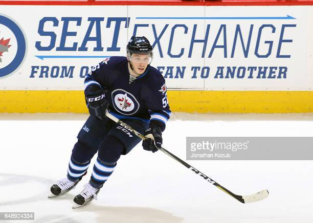 Marko Dano of the Winnipeg Jets keeps an eye on the play during third period action against the San Jose Sharks at the MTS Centre on March 6 2017 in...