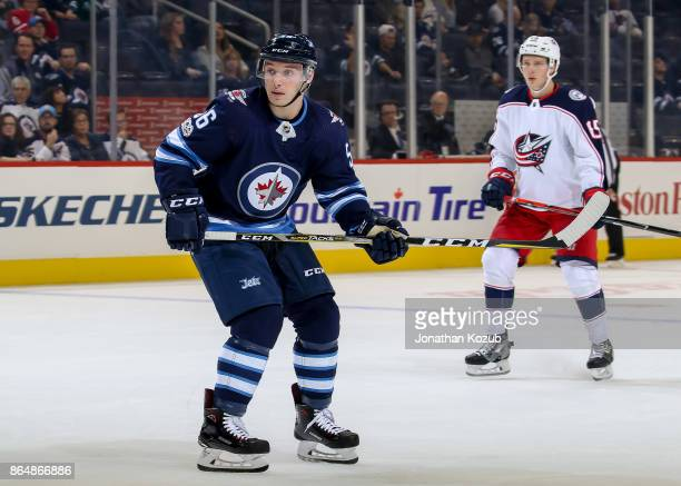 Marko Dano of the Winnipeg Jets keeps an eye on the play during third period action against the Columbus Blue Jackets at the Bell MTS Place on...