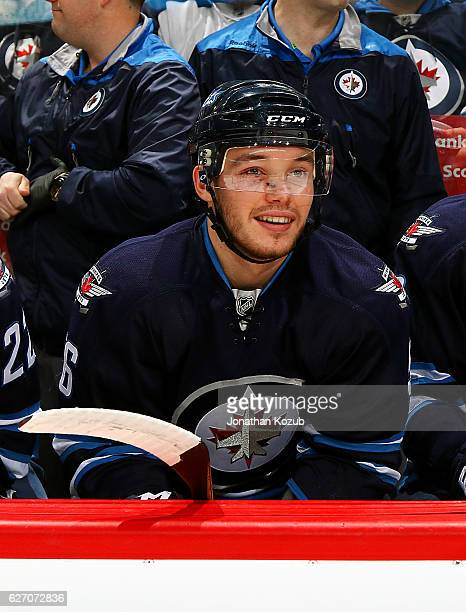 Marko Dano of the Winnipeg Jets looks on from the bench prior to puck drop against the Edmonton Oilers at the MTS Centre on December 1 2016 in...