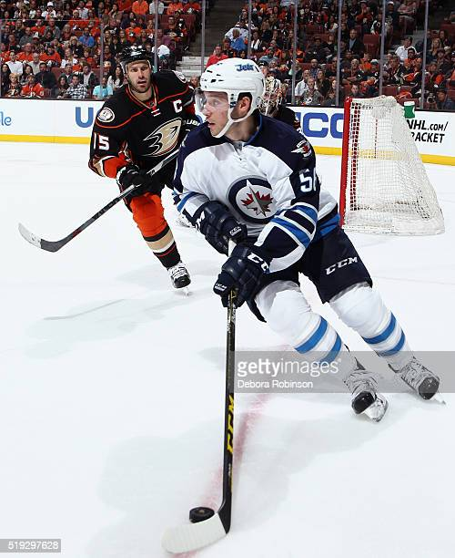 Marko Dano of the Winnipeg Jets skates with the puck against Ryan Getzlaf of the Anaheim Ducks on April 5 2016 at Honda Center in Anaheim California