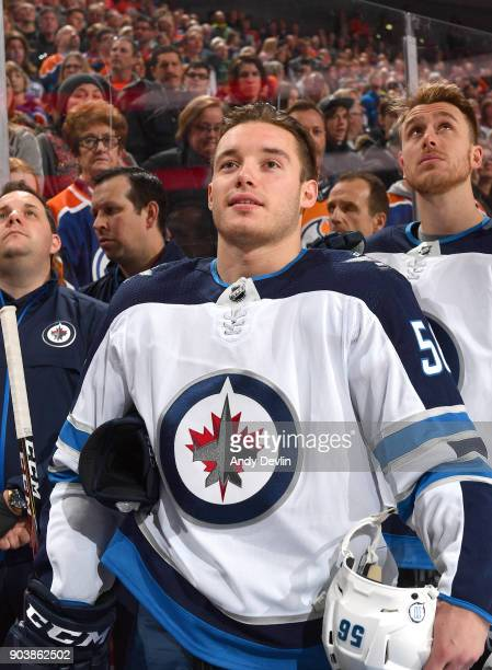 Marko Dano of the Winnipeg Jets stands for the singing of the national anthem prior to the game against the Edmonton Oilers on December 31 2017 at...