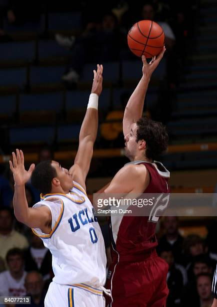 Marko Deric of the Loyola Marymount Lions shoots over Drew Gordon of the UCLA Bruins at Pauley Pavilion December 17 2008 in Westwood California UCLA...