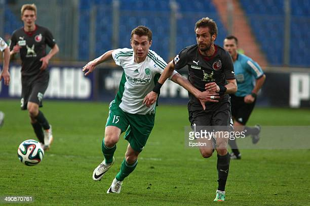 Marko Devic of FC Rubin Kazan is challenged by Andrei Semyonov of FC Terek Grozny during the Russian Football League Championship match between FC...