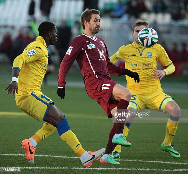 Marko Devic of FC Rubin Kazan is challenged by Bastos and Vitali Dyakov of FC Rostov Rostov-on-Don during the Russian Football League Championship...