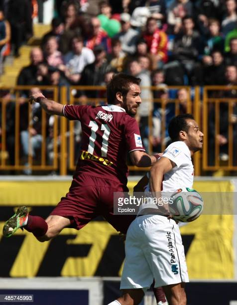 Marko Devic of FC Rubin Kazan is challenged by Joao Carlos of FC Spartak Moscow during the Russian Football League Championship match between FC...
