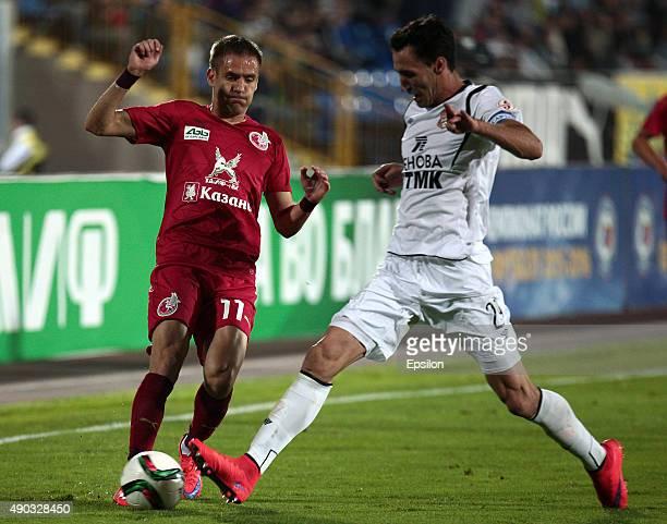 Marko Devic of FC Rubin Kazan is challenged by Pablo Fontanello of FC Ural Sverdlovsk Oblast during the Russian Premier League match between FC Rubin...