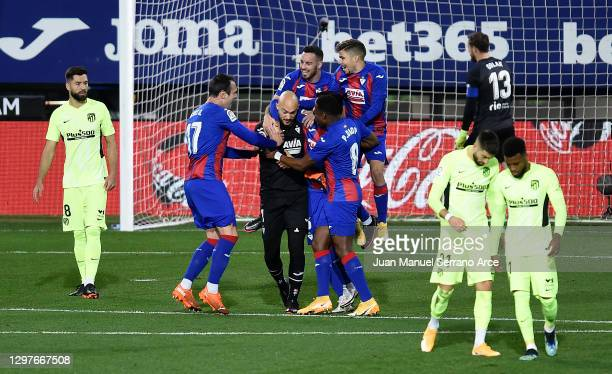 Marko Dmitrovic of SD Eibar celebrates with team mates after scoring their side's first goal from the penalty spot during the La Liga Santander match...