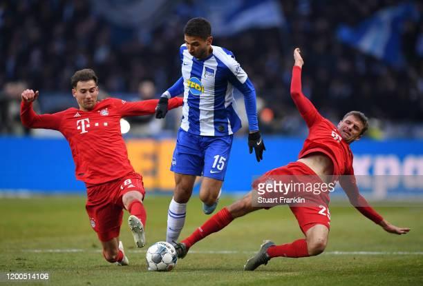 Marko Grujić of Hertha Berlin looks to break past Thomas Muller of FC Bayern Muenchen during the Bundesliga match between Hertha BSC and FC Bayern...