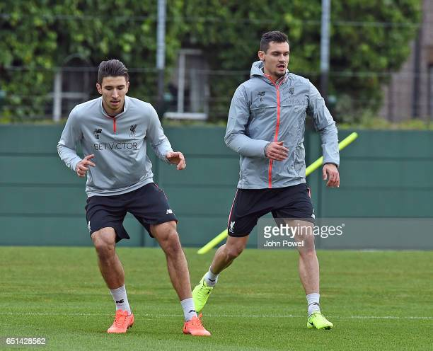 Marko Grujic and Dejan Lovren of Liverpool during a training session at Melwood Training Ground on March 10 2017 in Liverpool England