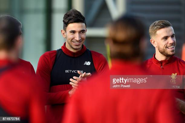 Marko Grujic and Jordan Henderson of Liverpool during a training session at Melwood Training Ground on November 16 2017 in Liverpool England