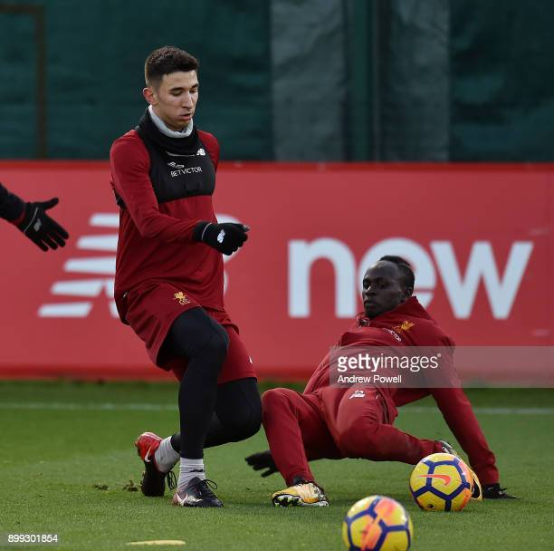 Marko Grujic and Sadio Mane of Liverpool during a training session at Melwood Training Ground on December 28 2017 in Liverpool England