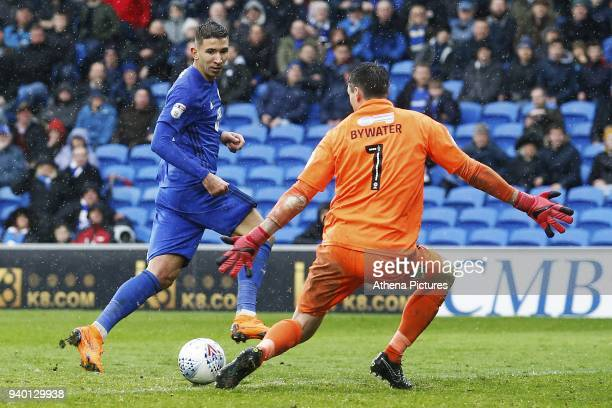 Marko Grujic of Cardiff City has a shot on goal against Stephen Bywater of Burton Albionthe Sky Bet Championship match between Cardiff City and...