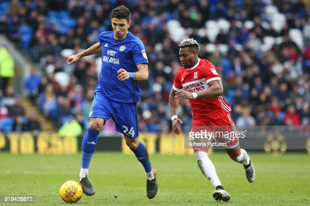 Marko Grujic of Cardiff City is marked by Adama Traore of Middlesbrough during the Sky Bet Championship match between Cardiff City and Middlesbrough...