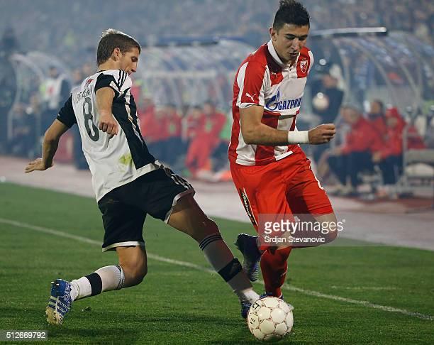 Marko Grujic of FK Crvena Zvezda in action against Darko Brasanac of FK Partizan during the Serbian Super League match between FK Partizan and FK...