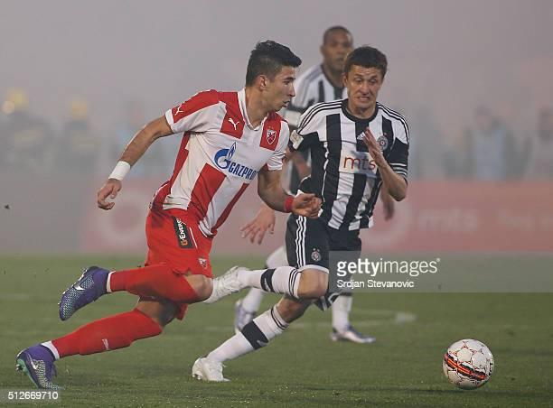 Marko Grujic of FK Crvena Zvezda in action against Sasa Ilic of FK Partizan during the Serbian Super League match between FK Partizan and FK Crvena...