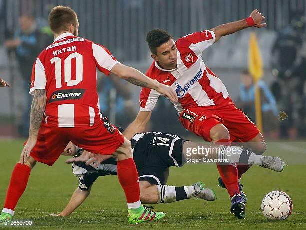 Marko Grujic of FK Crvena Zvezda is challenged by Miroslav Bogosavac of FK Partizan during the Serbian Super League match between FK Partizan and FK...
